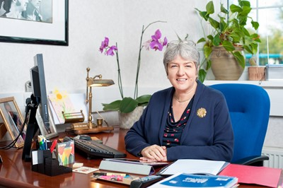 Jane Kennedy sitting at a desk
